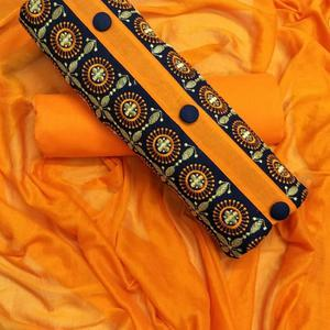 Glowing Orange Colored Partywear Embroidered Cotton Dress Material