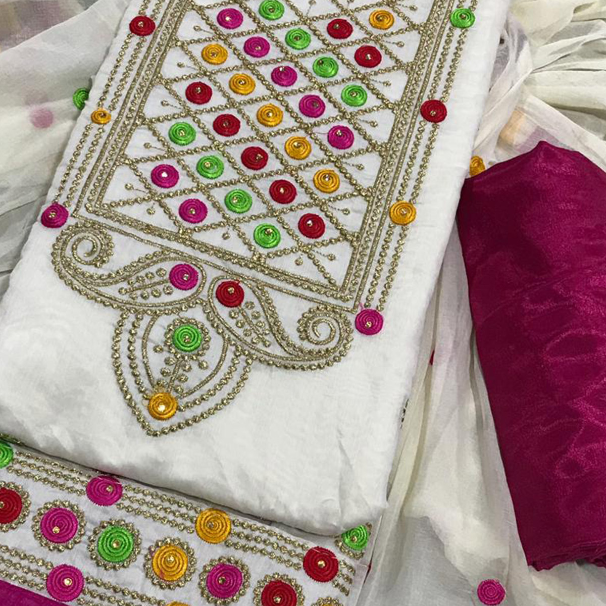 Magnetic White Colored Partywear Embroidered Chanderi Silk Dress Material