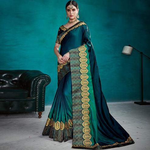 Staring Teal Blue Colored Party Wear Embroidered Satin Silk Saree