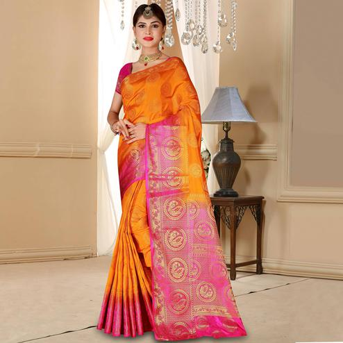 Pretty Orange Colored Festive Wear Woven Art Silk Saree