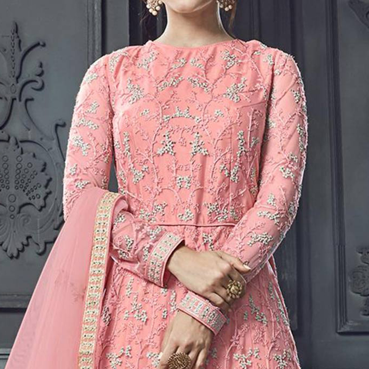 Adorable Light Pink Colored Party Wear Embroidered Heavy Net Anarkali Suit
