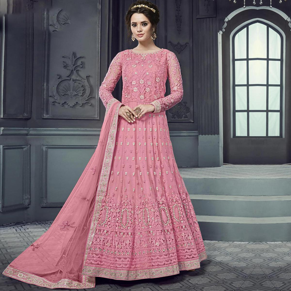 Attractive Pink Colored Party Wear Embroidered Heavy Net Anarkali Suit
