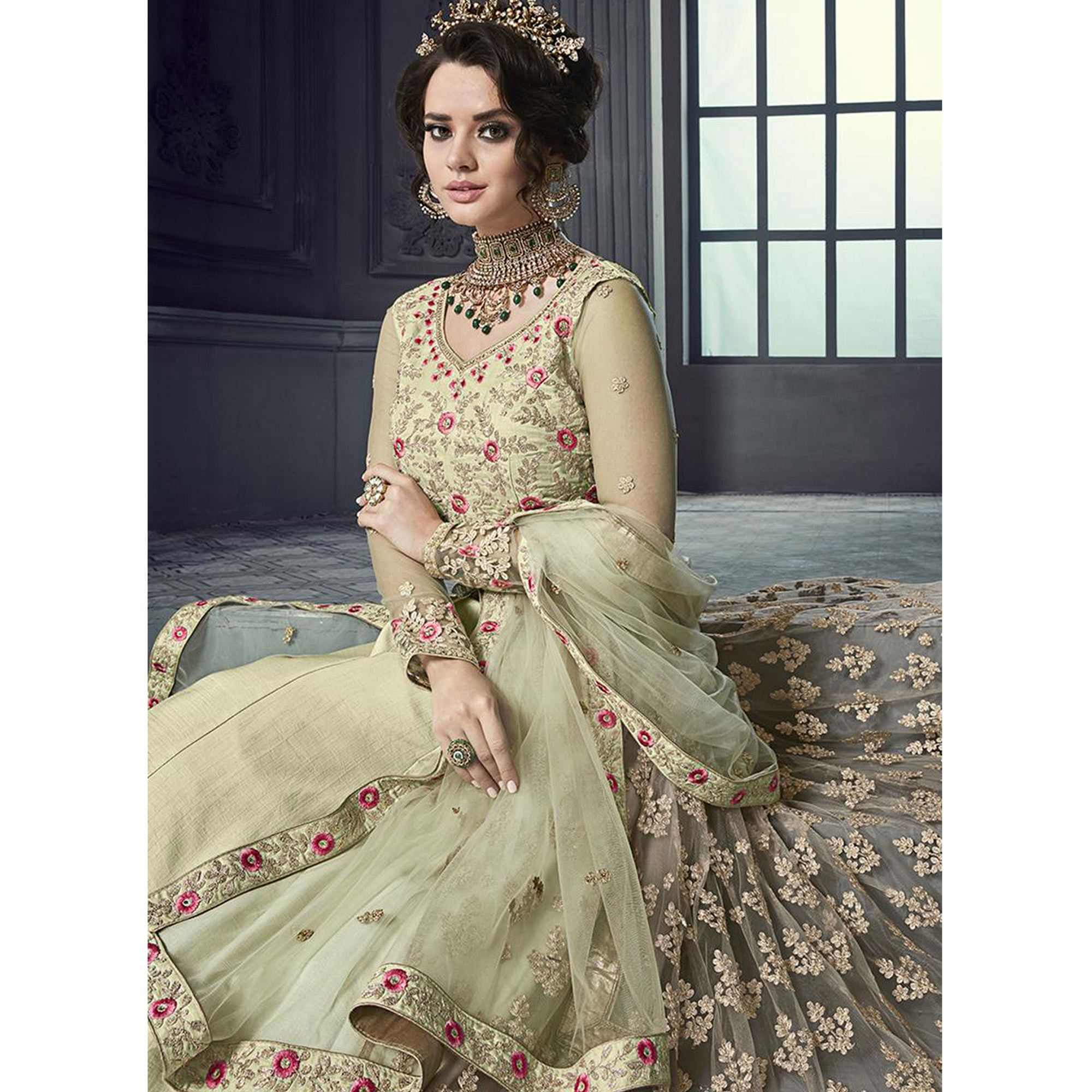 Beautiful Lemon Green Colored Party Wear Embroidered Heavy Net Lehenga Kameez