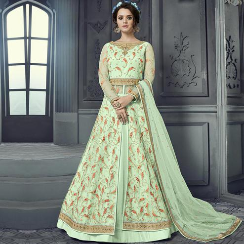 Gorgeous Mint Green Colored Party Wear Embroidered Heavy Net Lehenga Kameez