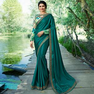 Stunning Teal Green Colored Partywear Embroidered Silk Saree
