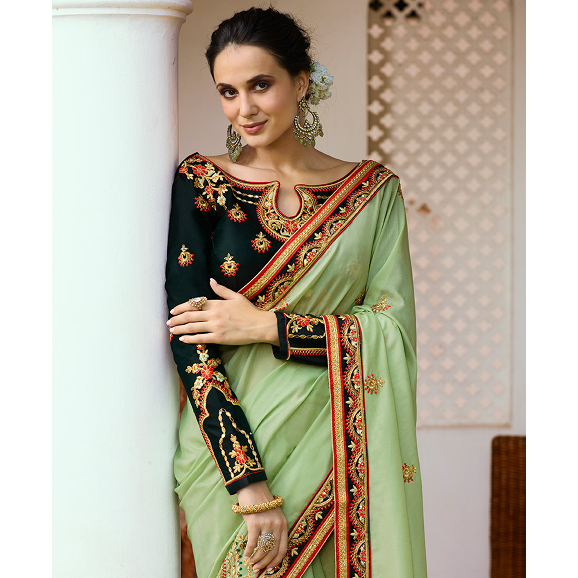 Refreshing Pale Green Colored Partywear Embroidered Silk Saree