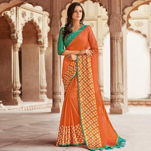 Graceful Orange Colored Party Wear Printed Linen Saree
