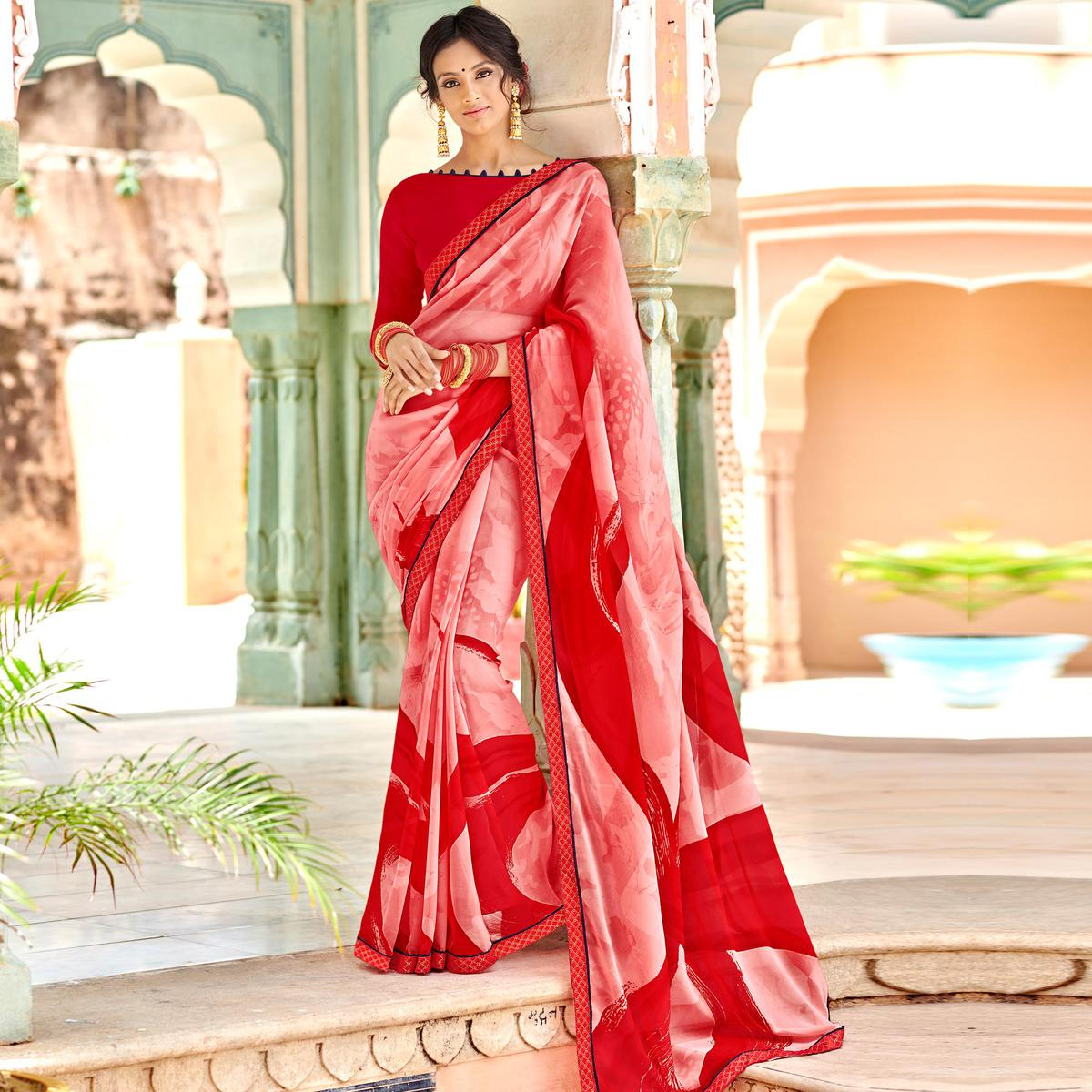 Pleasant Pink & Red Colored Casual Wear Printed Georgette Saree