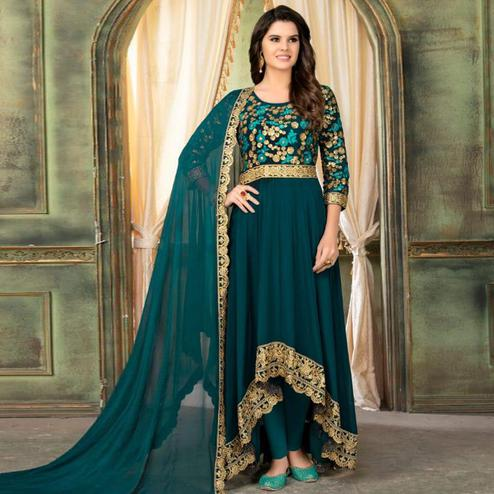 Different Teal Green Colored Partywear Embroidered Faux Georgette Anarkali Suit