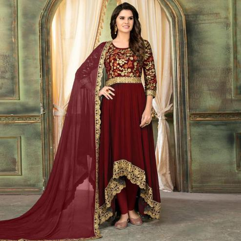 Marvellous Maroon Colored Partywear Embroidered Faux Georgette Anarkali Suit