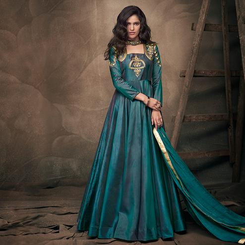 Alluring Teal Green Colored Party Wear Embroidered Tapeta Silk Gown