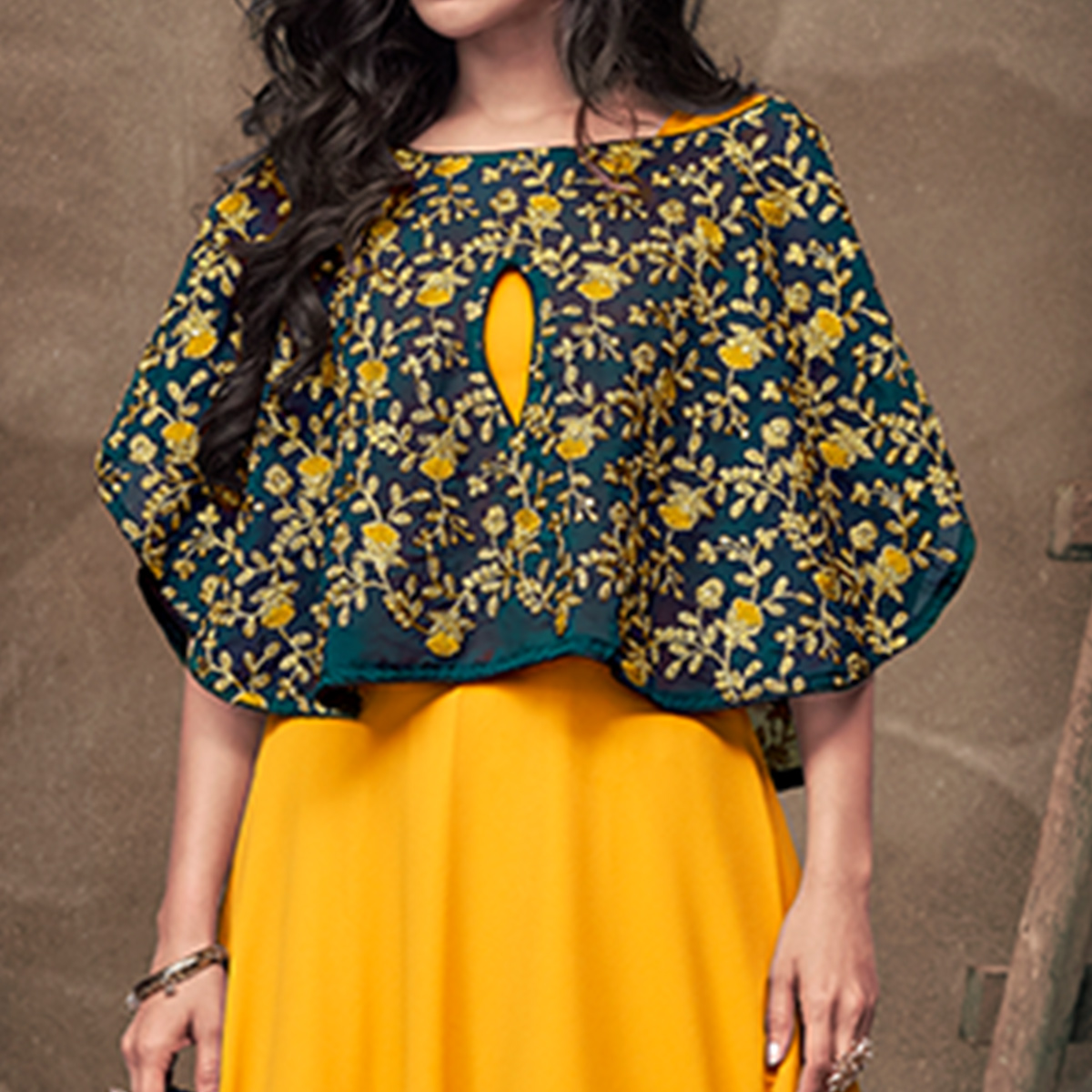 Radiant Yellow Colored Party Wear Embroidered Tapeta Silk Gown