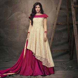 Flattering Cream - Pink Colored Party Wear Embroidered Heavy Net Lehenga Kameez