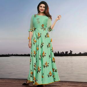Demanding Mint Green Colored Party Wear Printed Georgette Kurti
