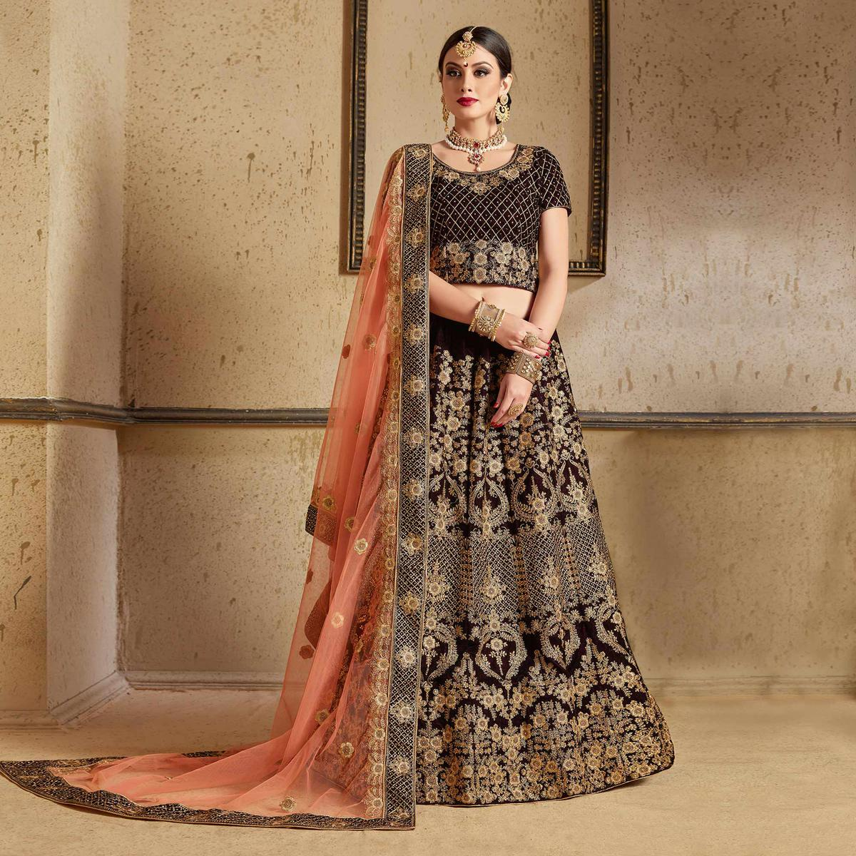 Stunning Navy Blue Colored Partywear Embroidered Pure Velvet Lehenga Choli