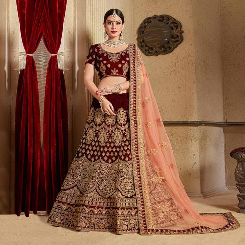 Flattering Maroon Colored Partywear Embroidered Pure Velvet Lehenga Choli
