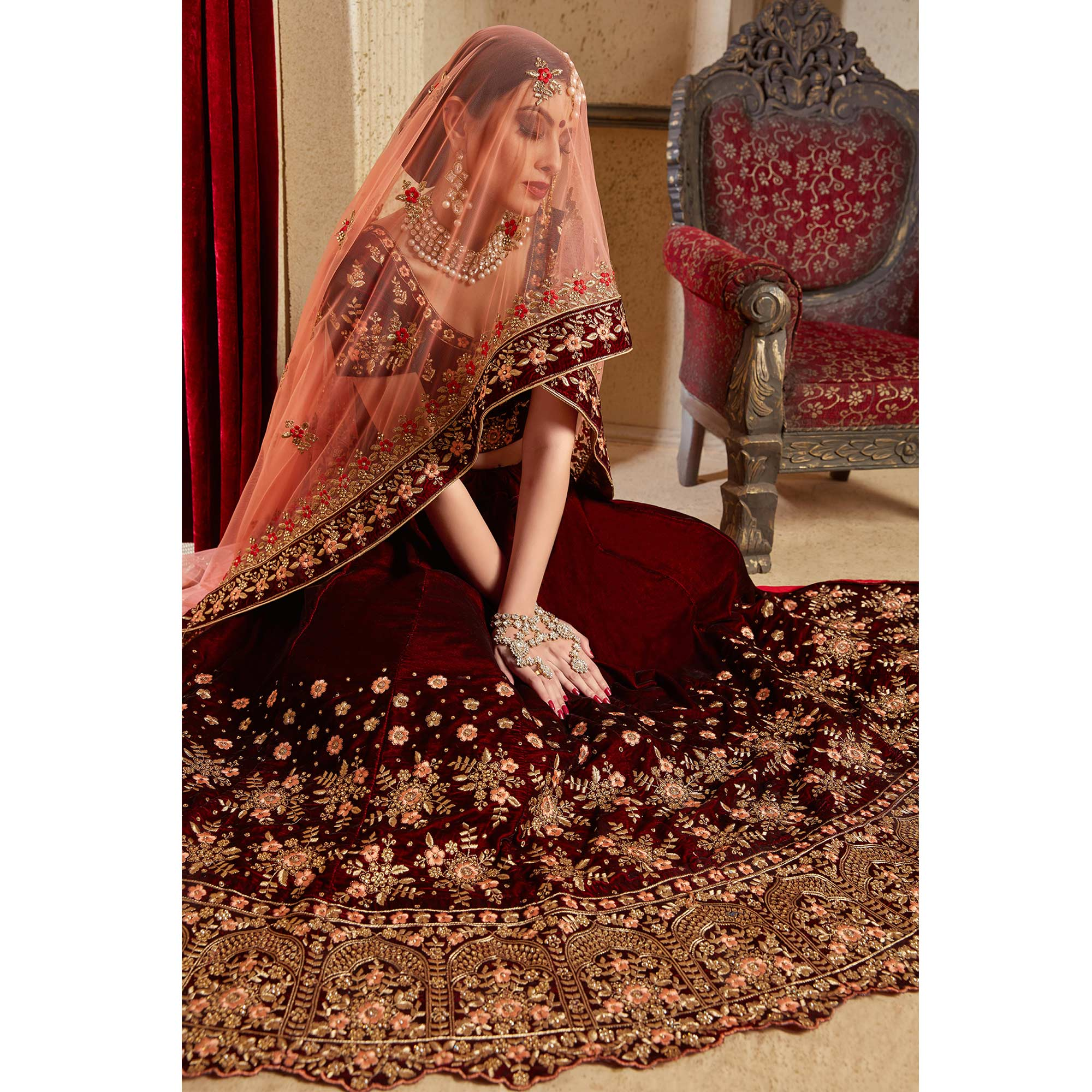 Sophisticated Maroon Colored Partywear Embroidered Pure Velvet Lehenga Choli