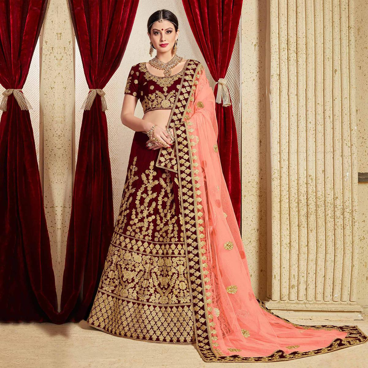 Arresting Maroon Colored Partywear Embroidered Pure Velvet Lehenga Choli
