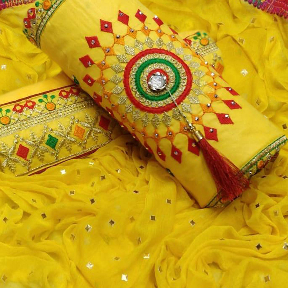 Flattering Yellow Colored Partywear Embroidered Cotton Dress Material