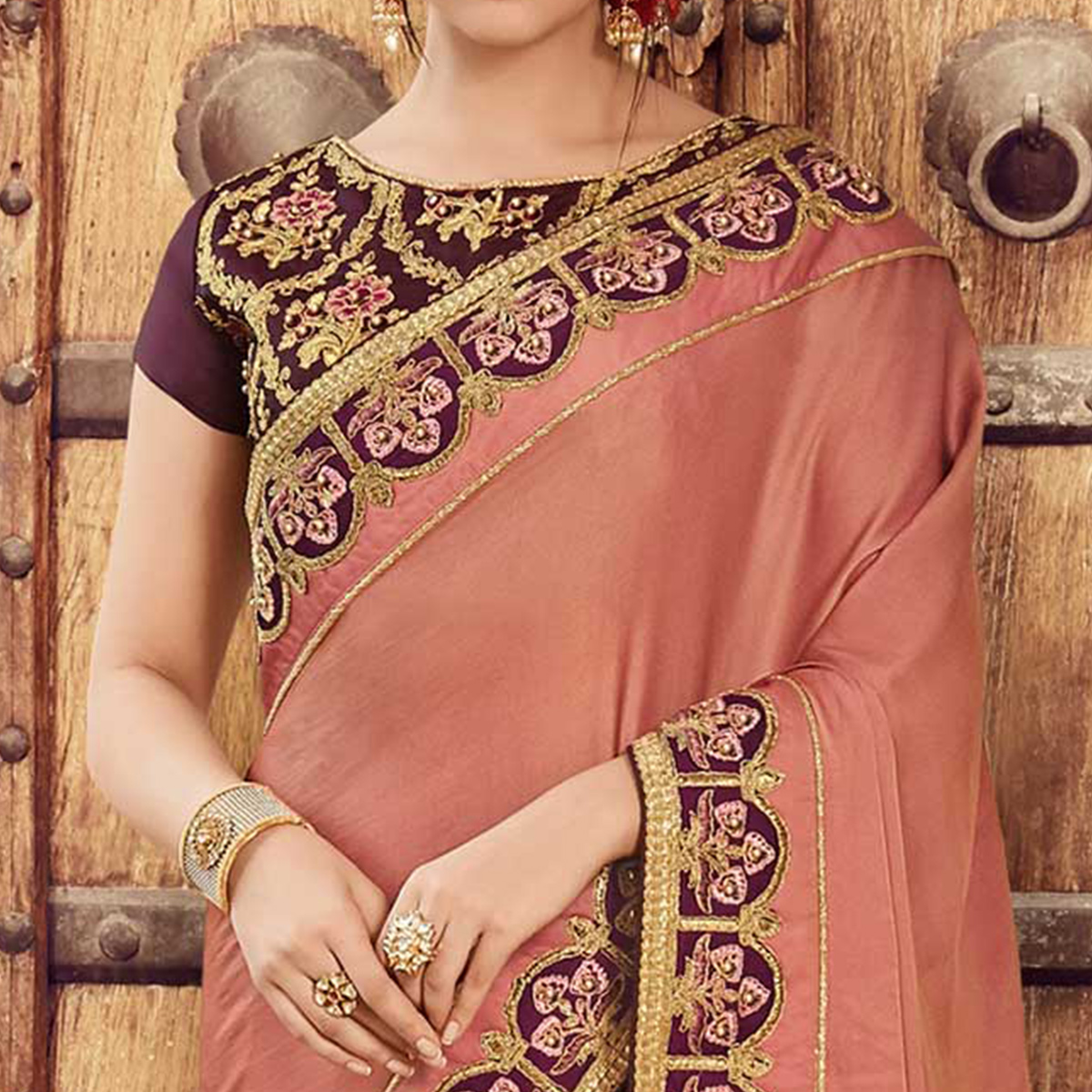 Adorning Peach-Wine Colored Wedding Wear Embroidered Satin Saree