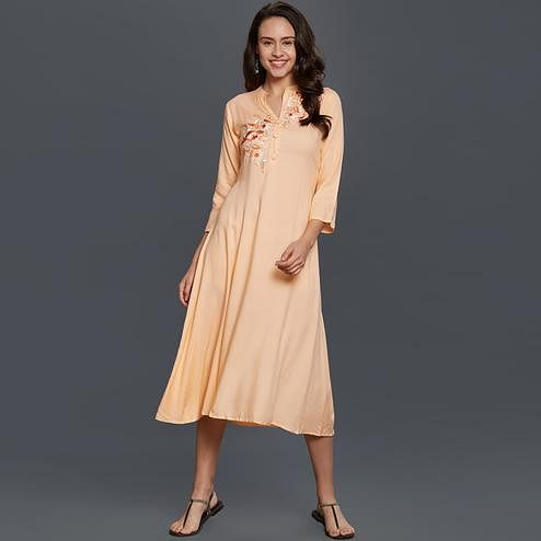 Attractive Peach Colored Partywear Embroidered Cotton Kurti