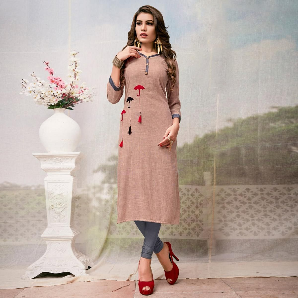 Marvellous Peach Colored Casual Embroidered Rayon Kurti