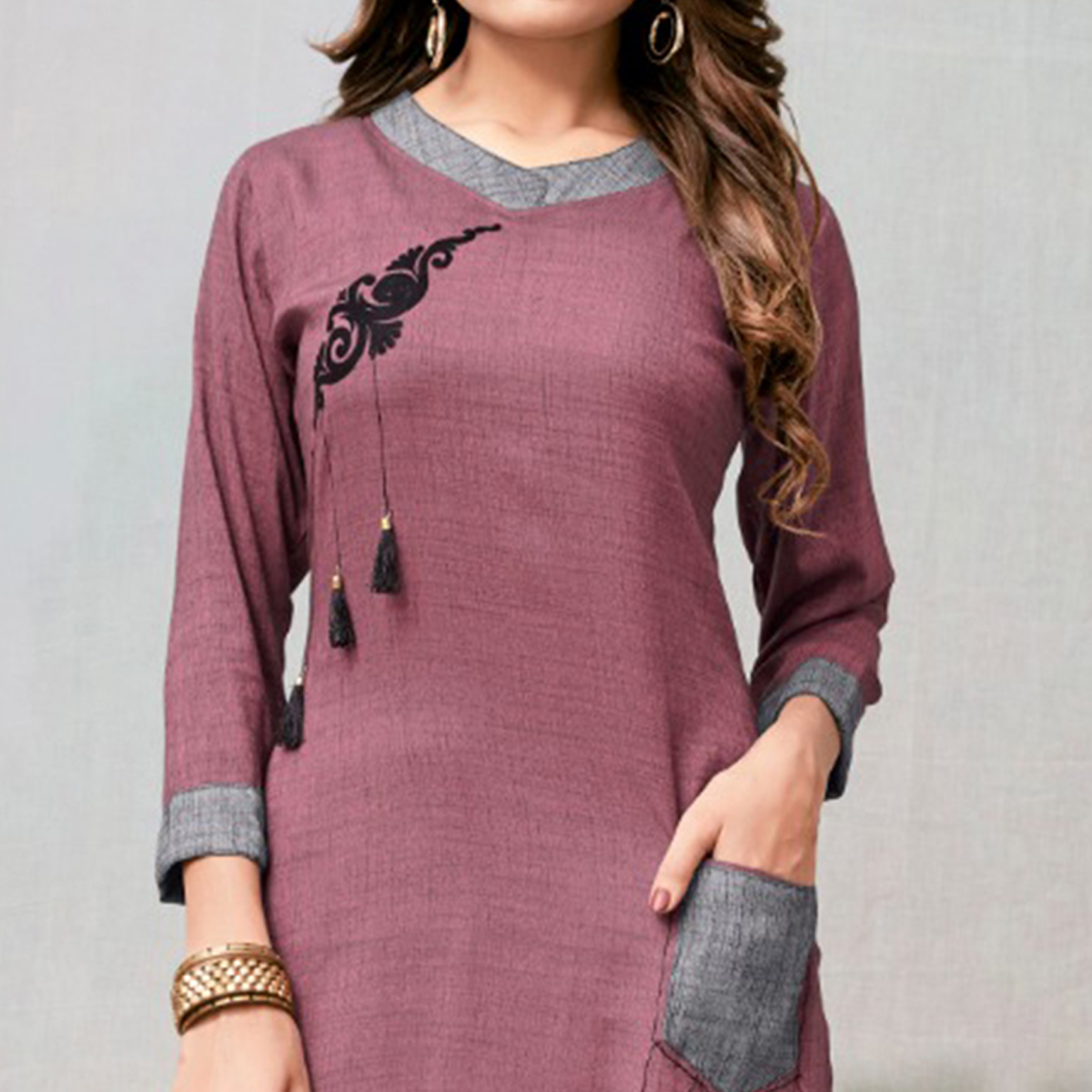 Eye-catching Mauve Colored Casual Embroidered Rayon Kurti