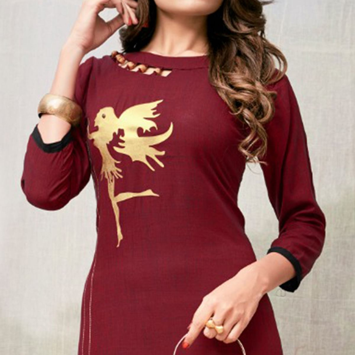 Lovely Maroon Colored Casual Embroidered Rayon Kurti