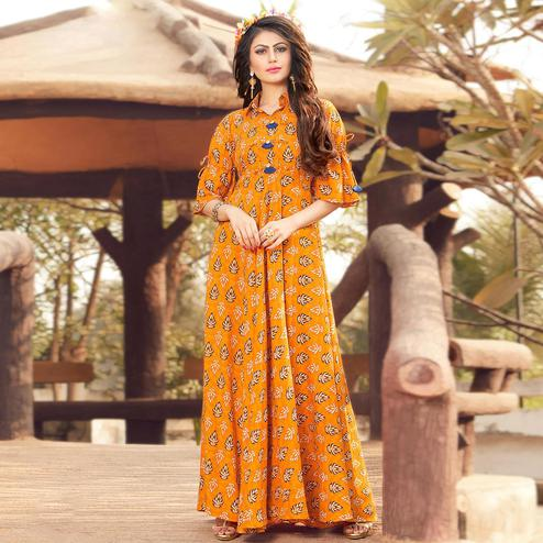 Adorable Orange Colored Party Wear Printed Rayon Gown