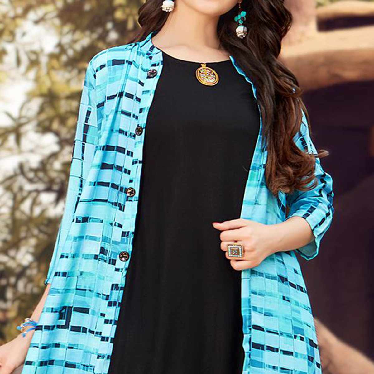 Classy Black - Sky Blue Colored Party Wear Printed Rayon Gown