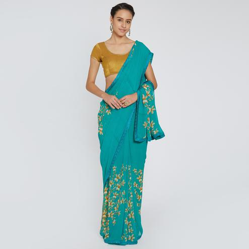 Intricate Turquoise Blue Colored Casual Wear Printed Georgette Saree