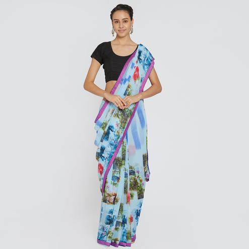Unique Aqua Blue Colored Casual Wear Printed Georgette Saree
