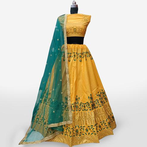 Gleaming Mustard Yellow Colored Partywear Embroidered Art Silk Lehenga Choli