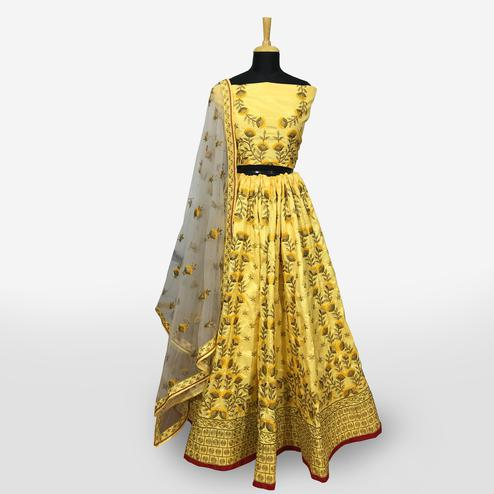Adorning Yellow Colored Partywear Embroidered Banarasi Silk Lehenga Choli