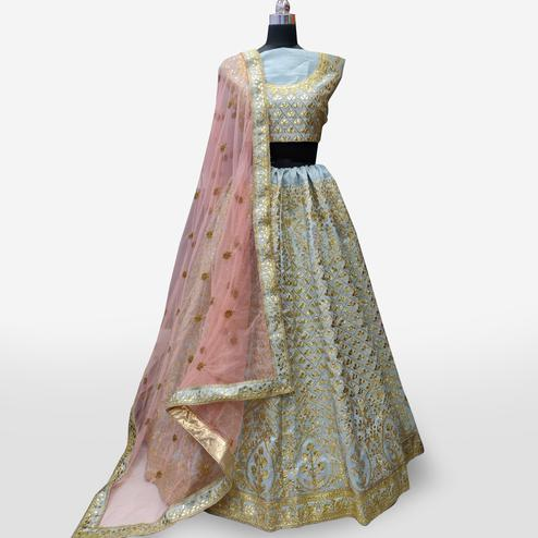 Refreshing Gray Colored Partywear Embroidered Mulberry Silk Lehenga Choli