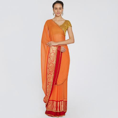 Impressive Orange Colored Casual Printed Georgette Saree