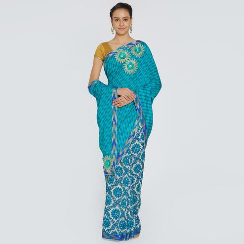 Unique Sky Blue Colored Party Wear Printed Georgette Saree