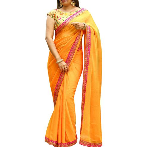 Amazing Yellow Colored Partywear Embroidered Georgette Saree