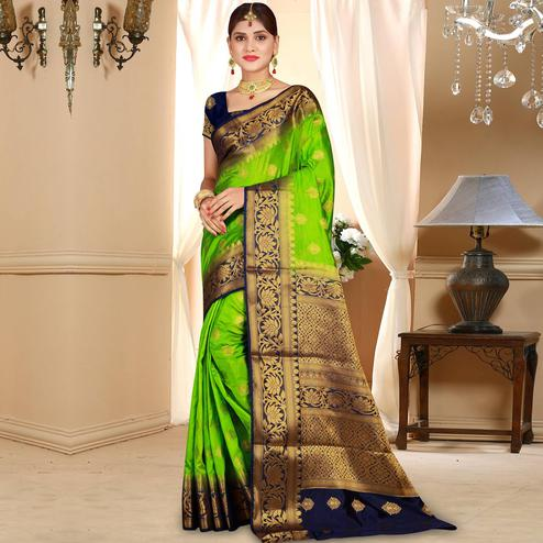 Adorning Parrot Green Colored Festive Wear Woven Art Silk Saree