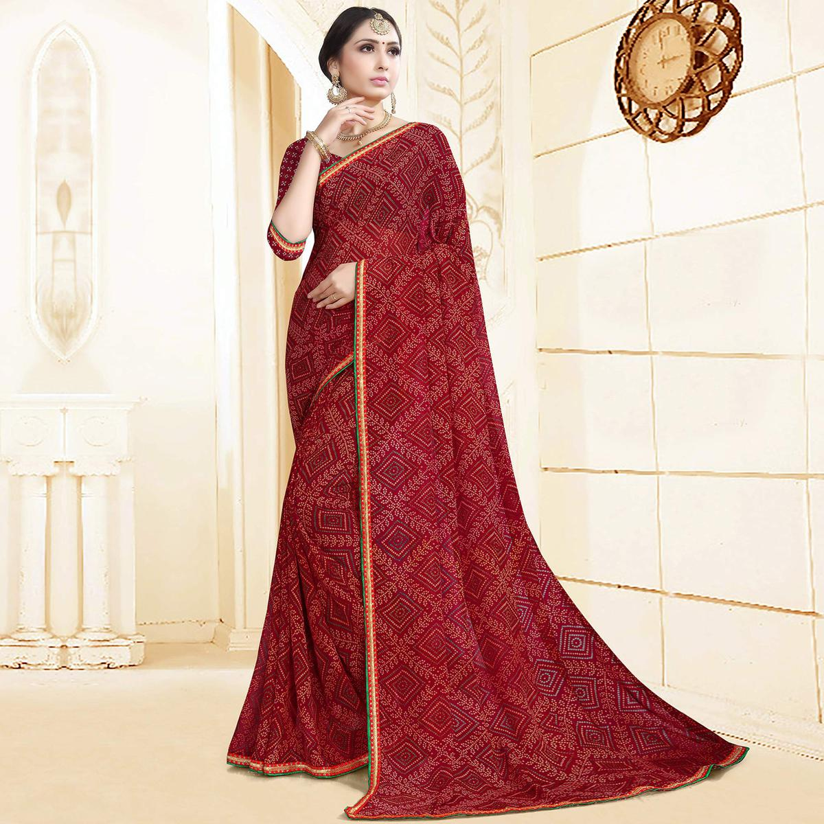 Staring Maroon Colored Casual Printed Georgette Saree