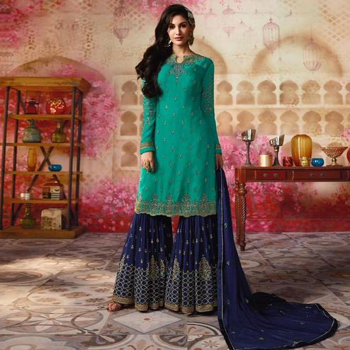 Gleaming Teal Green Colored Party Wear Embroidered Satin Georgette Palazzo Suit