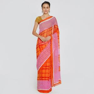 Beautiful Orange Colored Casual Printed Chiffon Saree