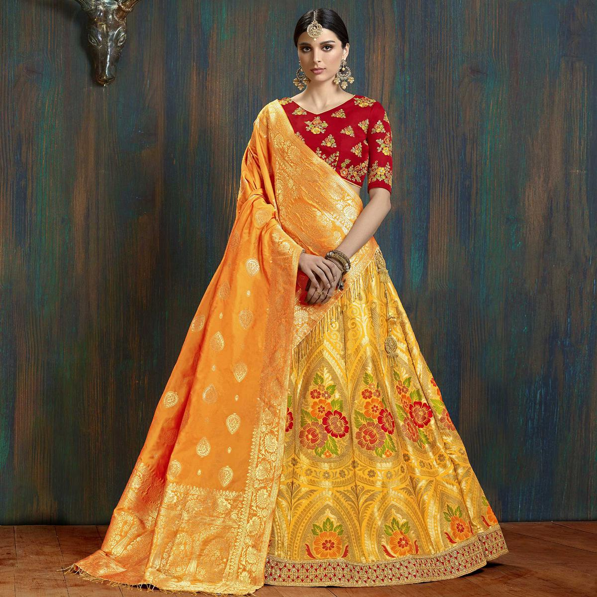 Eye-catching Yellow Colored Wedding Wear Embroidered Pure Banarasi Silk Lehenga Choli