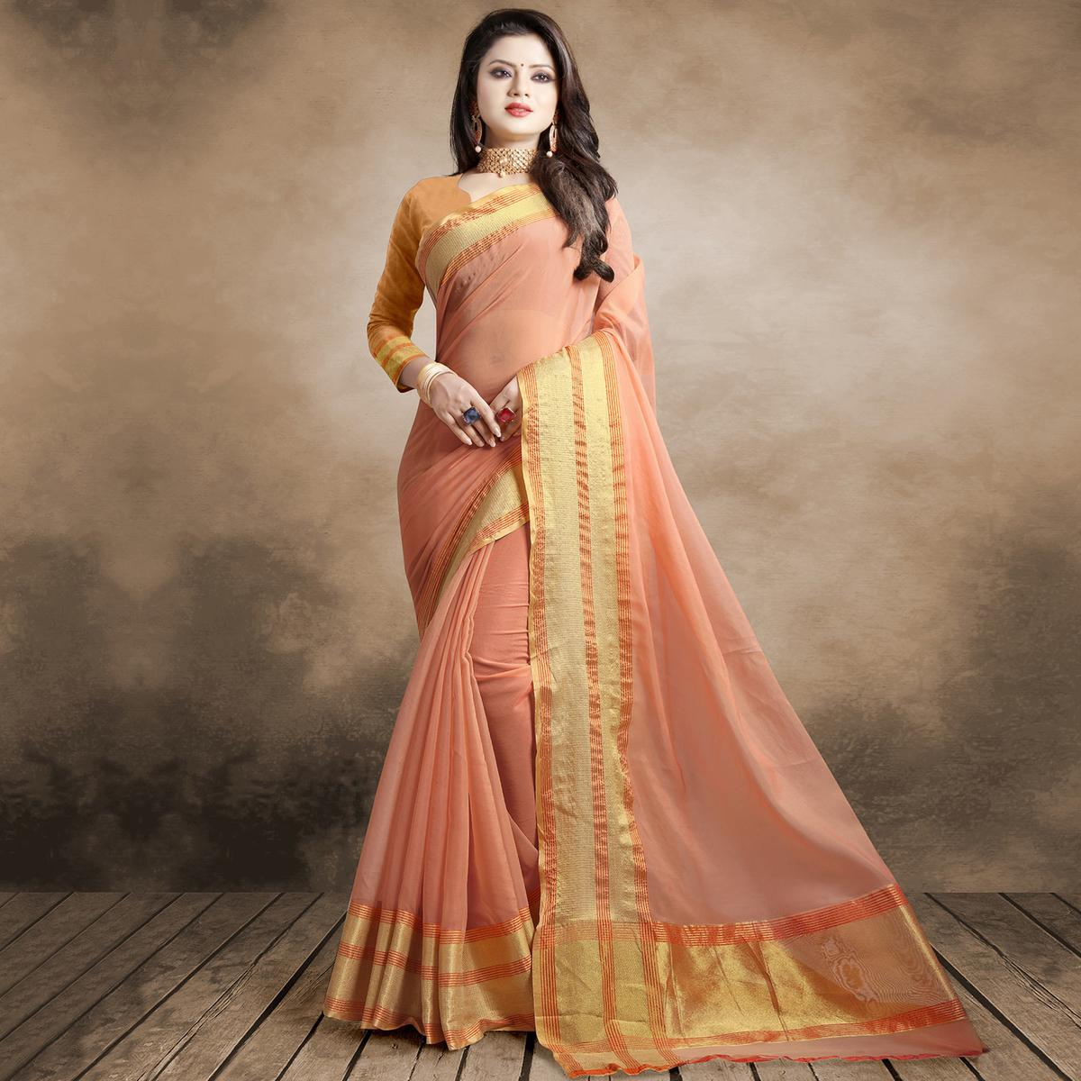 Stunning Light Peach Colored Festive Wear Organza Silk Saree