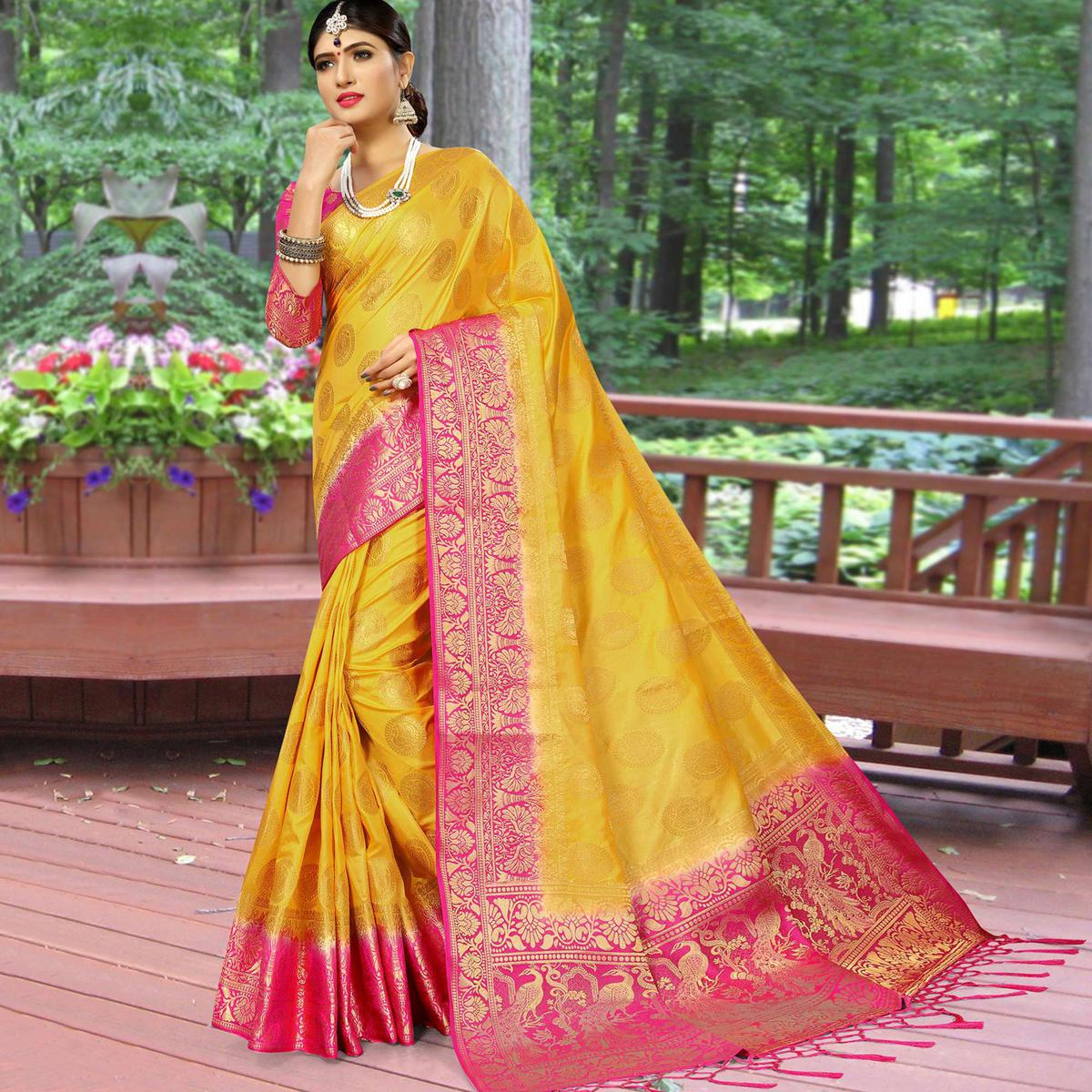 Radiant Yellow Colored Festive Wear Woven Work Soft Silk Saree