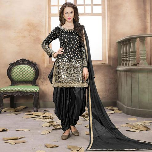 Hypnotic Black Colored Partywear Embroidered Tapeta Silk Patiala Suit