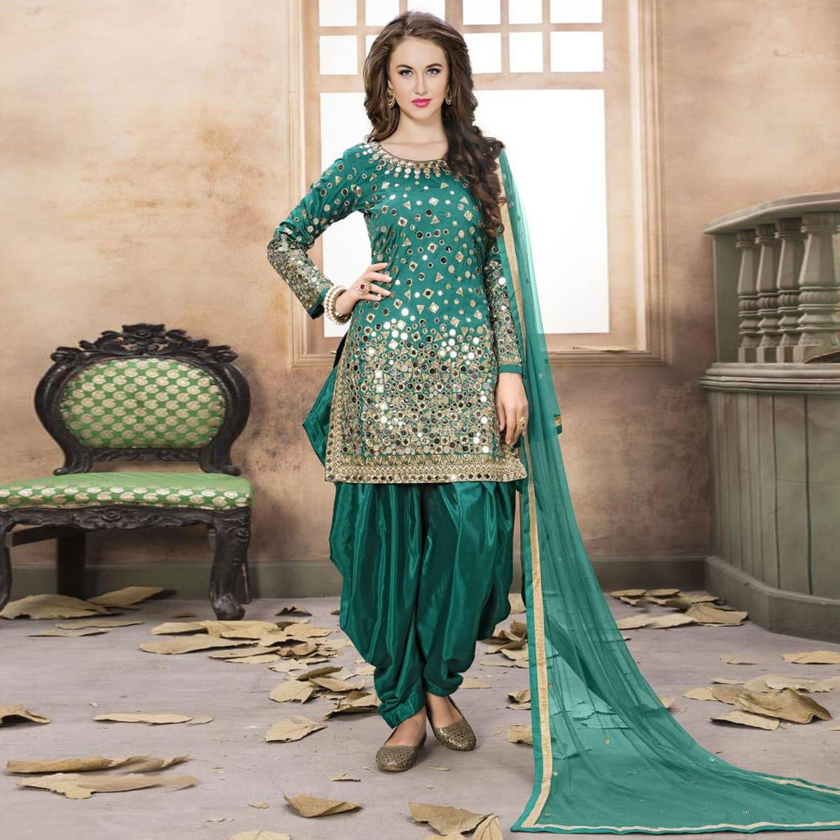 Refreshing Turquoise Green Colored Partywear Embroidered Tapeta Silk Patiala Suit