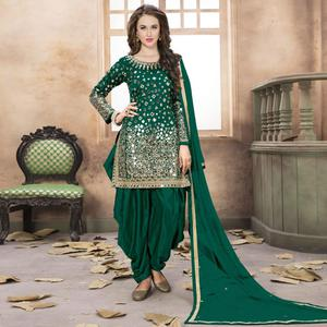 Stunning Green Colored Partywear Embroidered Tapeta Silk Patiala Suit