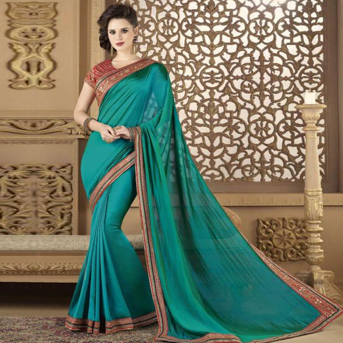 Desirable Teal Blue Colored Partywear Embroidered Silk Saree.