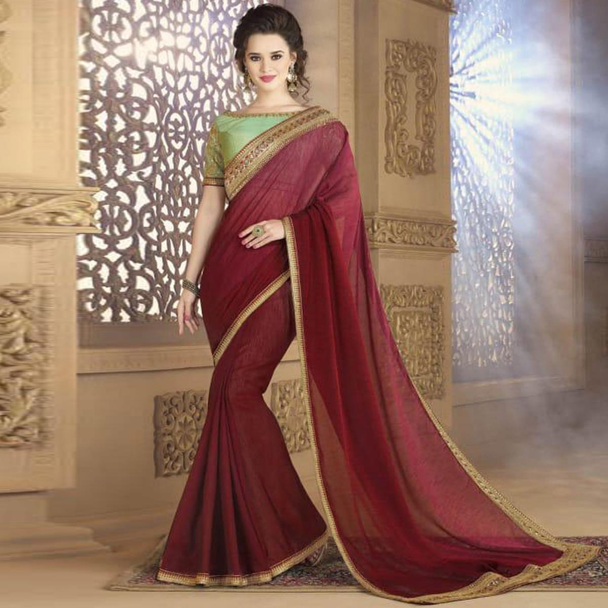Sophisticated Maroon Colored Partywear Embroidered Silk Saree.